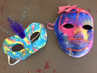 two painted theater masks